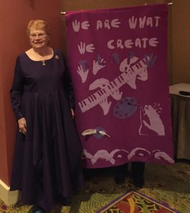 "Virginia Campbell with her quilt titled, ""We are what we create."""