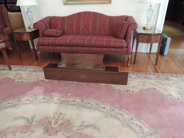 A gift of a parlor sofa to replace the unsafe one.