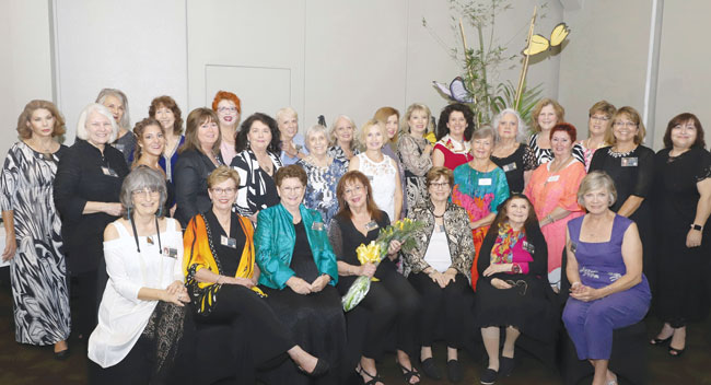 Pensacola Pen Women gather at the celebration of their branch's 75th anniversary.